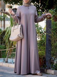 You asked for it, and we are happy to oblige: Finally, a wrinkle-resistant version of our popular abayas! The name says it all, and it's as easy to wear as it is to care for. Elasticized sleeves, a front opening, and the perfect flattering, feminine flair work together to create one beautiful, practical piece you'll be reaching for day after day.
