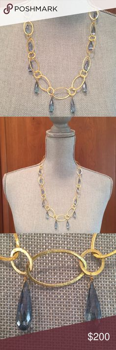Blue Topaz and Gold Necklace Stunning necklace from designer Sissy Yates. Blue topaz teardrop stones dangle from 18k gold plated discs. Delicate toggle closure. Sissy Yates Jewelry Necklaces