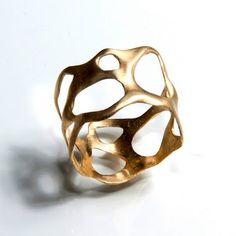 Avant-garde gold ring by D.M. design