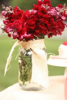 Flowers in mason jars with burlap