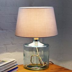 This lamp base has several unique features: made from recycled glass, it is fitted with a multi coloured cotton braided flex and a cork stopper at the top for the bulb holder. Interior Styling, Interior Decorating, Cork Stoppers, Hotel Decor, Hotel Interiors, Luxury Decor, Cottage Living, Lamp Bases, Recycled Glass