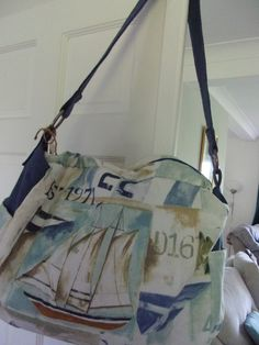 Nautical theme weekend bag, featuring sea boats and lighthouses, finished with a blue heavy duty single shoulder strap Free Motion Embroidery, Nautical Theme, Lighthouses, Dressmaking, Boats, Shoulder Strap, Handmade Items, It Is Finished, Sea