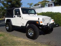 View Photos & Details of a 2006 USED JEEP WRANGLER Unlimited located in Encinitas, CA at Cardiff Classics | Stone White Clearcoat