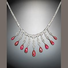 An art deco diamond, ruby and platinum necklace, Lacloche Freres, France.