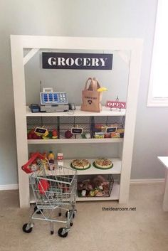 DIY Kid's Grocery Stand. Cute DIY grocery store for the kids to play with! #kidstoyplay