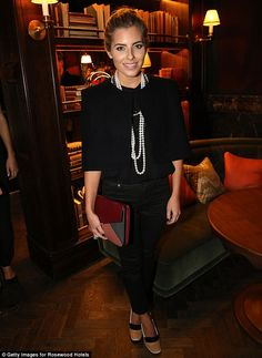 So chic: Mollie wore an all black outfit with pearls draped around her neck