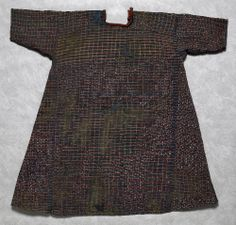 EGYPT: 9 or 10 c. This checked tunic measures 75.5 cm long and 77 cm wide (30 x 31 inches), the size of a young child. It is hand-woven of red, blue and yellow wool in an unusual plaid pattern with undyed linen. The maker tailored separate sleeves and side gores, and finished the neck with red binding and a button and loop closing.