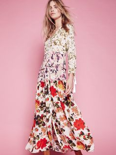 Mixed Floral Maxi Dress   Featuring mixed floral prints this tiered maxi dress is all things elegant, boho and ethereal, featuring button closures down the front and a V-neckline. The long sleeves have flutter cuffs with adjustable ties and tassel ends. Raw ruffle trim throughout.