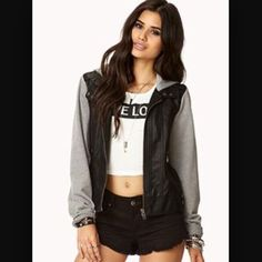 """SOLD Grey Sleeve and Faux Leather Hoodie Love this jacket. Size large. Fits a medium. Arm length 25"""" body length 21"""" width 18"""" once across Jackets & Coats"""