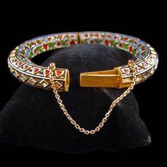 A Mughal Gold, Diamond, Ruby and Enamel Bangle