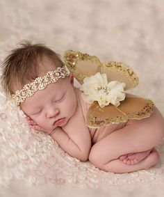 This Brown & Ivory Glitter Wings & Rhinestone Headband is perfect! #zulilyfinds