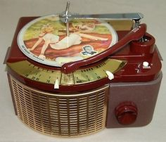 Streamline deco Bakelite record player with 1940s picture discs.  Zenith Cobra-Matic record changer, 1950