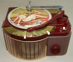 Streamline deco Bakelite record player with 1940s picture discs.