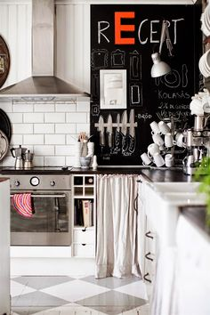 Nice kitchen design idea with white tile, chessboard floor and chalkboard wall