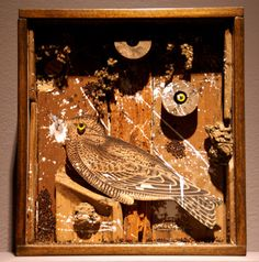 """Bird in a Box,"" by Joseph Cornell, wood, cork, branches, paint, printed paper and grains in wood and glass box construction"