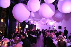 Giant balloons suspended from the ceiling served as the focal point at the DX Gala. What's more is that the color-washed room was updated with a new hue with each course.
