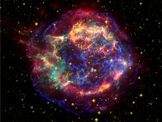 Cassiopeia A -- This stunning picture of the supernova remnant Cassiopeia A (Cas A) is a composite of images taken by three of NASA's Great Observatories. Infrared data from the Spitzer Space Telescope are colored red; optical data from the Hubble Space Telescope are yellow; and X-ray data from the Chandra X-ray Observatory are green and blue.