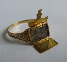 The 1881 envelope mourning ring showing how it opened to allow hair to be put inside as a keepsake.