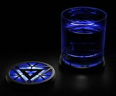 Protect your table the Tony Stark way with these awesome Marvel Iron Man 3 Arc Reactor Light-Up Coasters. They light up. Just like Iron Man's arc reactor. This Iron Men, Iron Man Arc Reactor, Marvel Room, Nerd Cave, Geek Decor, Basement Remodeling, Drink Coasters, Cool Gadgets, Geek Gadgets