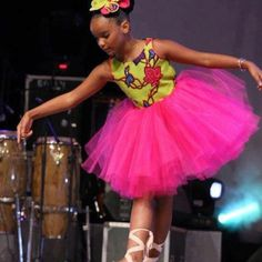 if i have a little girl and she gets in ballet, I am going to make her an african print leotard and tutu like this