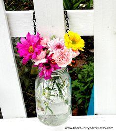 gorgeous!  i knew i was saving my blue mason jars for something...    Hanging Mason Jar Flower Vase With Frog Lid  by TheCountryBarrel, $12.50