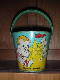 RARE Antique Rose O'Neill Kewpie Scootles Tin Sand Castle Pail Kewpie Beach...seriously can someone buy this for me?