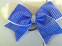 Check out this item in my Etsy shop https://www.etsy.com/listing/198475965/royal-blue-bling-on-white-cheer-bow