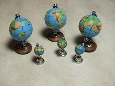 Tutorial on Creating a Miniature Globe;  It is in Russian but you can use Google Translator to read it in English