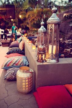 moroccan-vibe pillows & lanterns would look great under a pergola