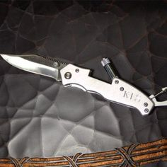 Possible groomsmen gifts: Personalized Utility Pocket Knife With Flashlight