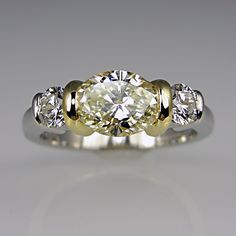 Oval yellow diamond with white diamonds on the side