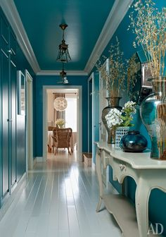 I Adore the Contrast of the Teal Walls Against the White Flooring. Just Beautiful!!