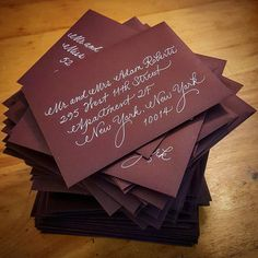 Fancy Script in white ink on burgundy matte envelopes {Calligraphy by Carrie}