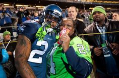 "Marshawn ""Beast Mode"" Lynch of the Seattle Seahawks with his mom www.footballfanhq.com"