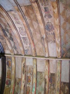 The painted roof in the Tudor Chapel at Ightham Mote showing symbols of Henry VIII and Catherine of Aragon. Said to be from the roof of one of Henry8th's tents at the field of cloth of gold.