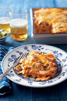 Layers of corn tortillas give this ultra-creamy casserole some structure. We also love it with smoky shredded BBQ brisket or pulled pork in place of the chicken, or try small cooked, peeled shrimp.    Recipe:Chicken Enchilada Casserole