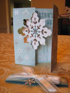 Sandi's Snowflake Thinlit Die card decorated with Letterpress Christmas, All is Calm dsp & Snowflakes, Frosted Sequins, & more. All supplies from Stampin' Up!