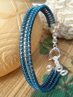 Dark peacock blue wire wrapped woven bangle handmade by catinalife, $32.00
