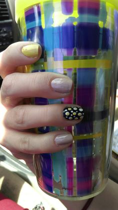 """July 13, 2015. Wet n Wild's """"yo soy"""", (yellow), and (black nail polish) dotted in white and yellow. Looked like fried eggs, but striking fried eggs! Thanks Tervis for the awesome backdrop!"""