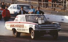 """The Ramchargers 1965 A/FX car was one of the original """"funny cars"""".So called because of the odd look that altering the wheelbase to get more weight behind the rear wheels."""