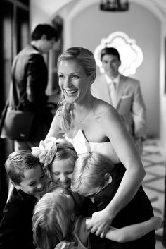 Shot of bride with flower girls and ring bearers