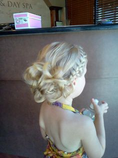 "Flower girl or bridesmaid hair...side french braid back. Depending on hair texture, the ""bun"" could be a bunch of curls pinned for a more sleek look, or keep loose like this. Simple and pretty."