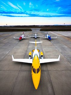 Colorful fleet of Honda-Jets on the ramp. One for each Teletubby.