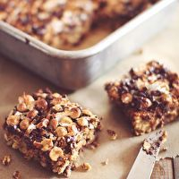 7 Layer Protein Bars by ERIN WRIGHT  notes  160 calories each, 5 g fat, 2 g fiber, 9 g protein