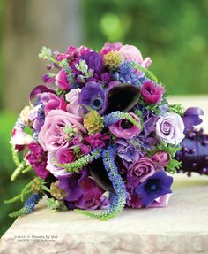 Purple, blue, lavender, green and fushia wedding bouquet with roses and calla lilies. Design by Flowers by Jodi. Photo ©CWLIFE Photography.