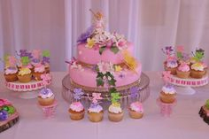 Gorgeous cake at a fairy birthday party! See more party planning ideas at CatchMyParty.com!