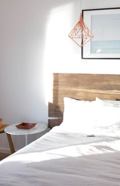 With an eye-catching piece like a reclaimed wood poster bed, keeping the ben linens simple provides a nice, calming contrast.
