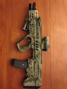 MI Extended Foregrip and Light-Mount. Ergonomic hand stop set-up. I want this Tavor.