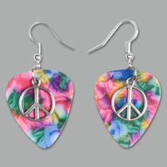 A combination of guitar pick and jewelry charm -- show off your whimsical music side with these fun pink peace sign guitar pick earrings! $12