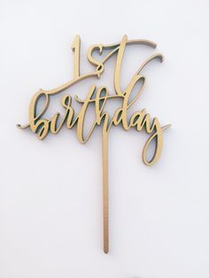 First Birthday Cake Topper  This is a laser cut wooden cake topper. It is hand drawn, laser cut from MDF wood, and is available in gold, silver, white, copper, or glitter (gold, silver, or champagne glitter). If there is a specific color you would like it to be painted please send us a message and we will let you know if we can accommodate you. The painted cake toppers are coated with shellac to make them food safe! These measure at around 5 inches wide and 3.5 inches tall, not including the…